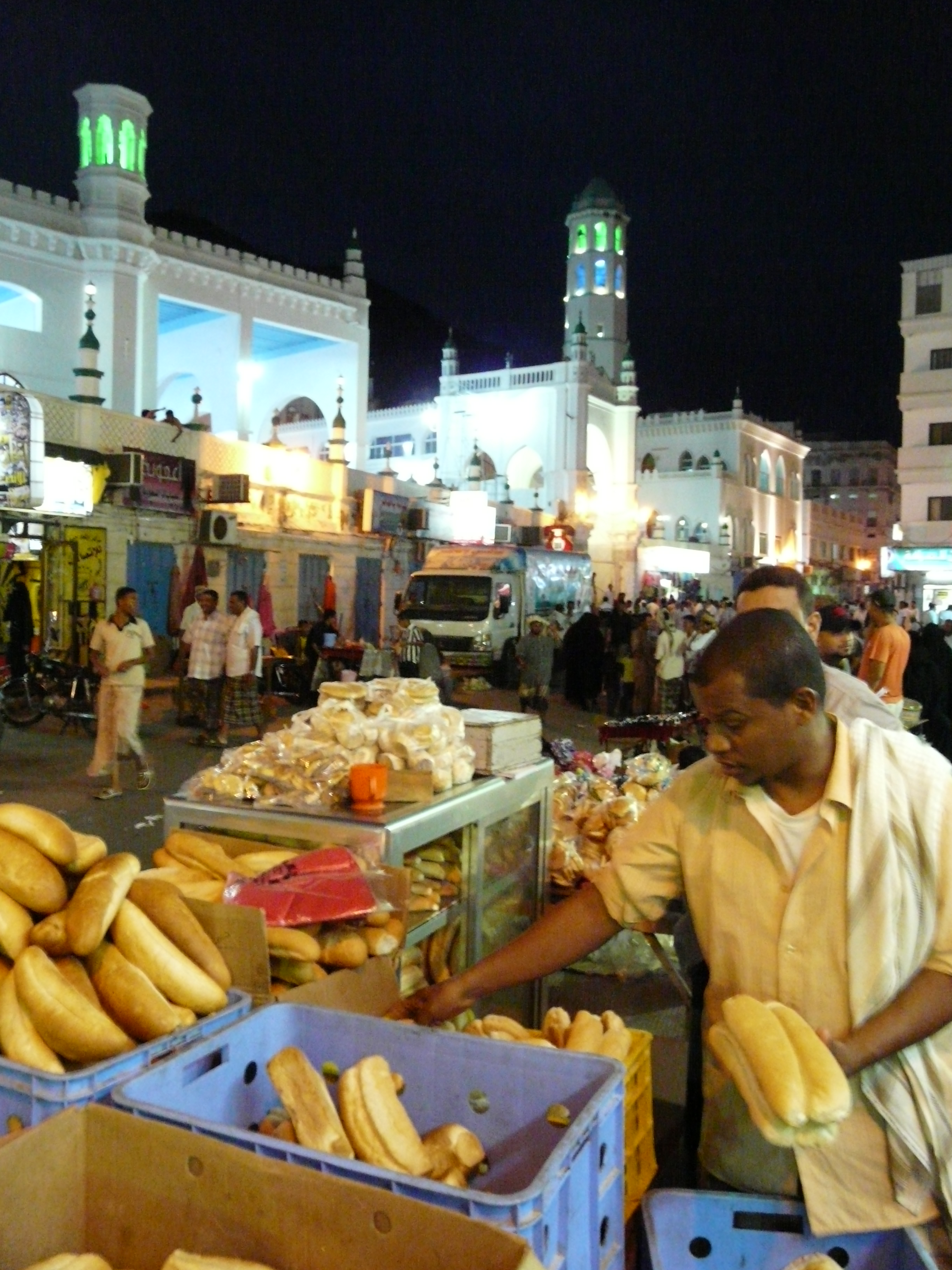Al Mukalla Square in the Old City of Mukalla_Trading bread in the late evening. Photo taken on February 8, 2010.