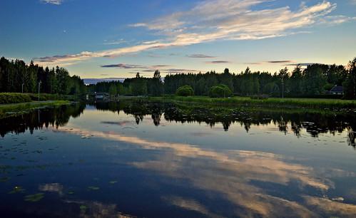 Reflections. Night on the lake Päijänne, Finland, summer. Time is 22:37.