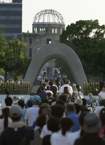 People pray in front of the Cenotaph for A-bomb victims at the Peace Memorial Park in Hiroshima, western Japan, on Aug. 6, 2018, as the city marks the 73rd anniversary of the U.S. atomic bombing. From mainichi.jp