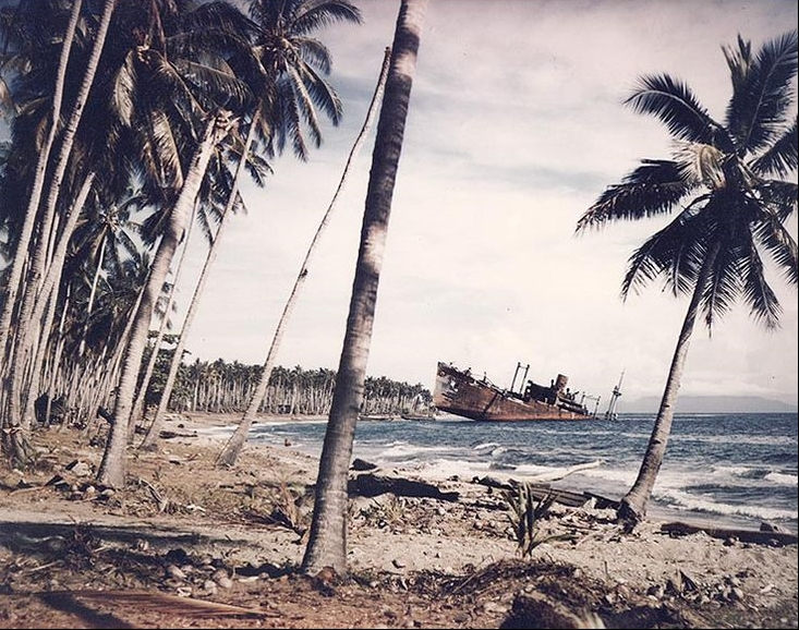 The wreck of one of the four Japanese transports, Kinugawa Maru, beached and destroyed at Guadalcanal on November 15, 1942, photographed one year later.