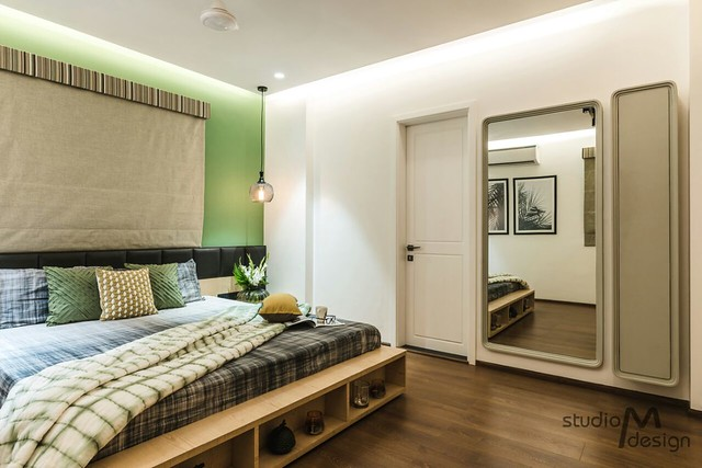 Bedroom Guest with green walls and golden curtains. full length wall paneled mirror