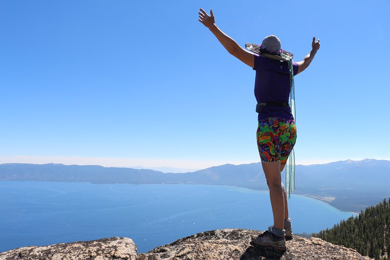 Vicki taking in the view of southern Lake Tahoe from the summit of Jakes Peak