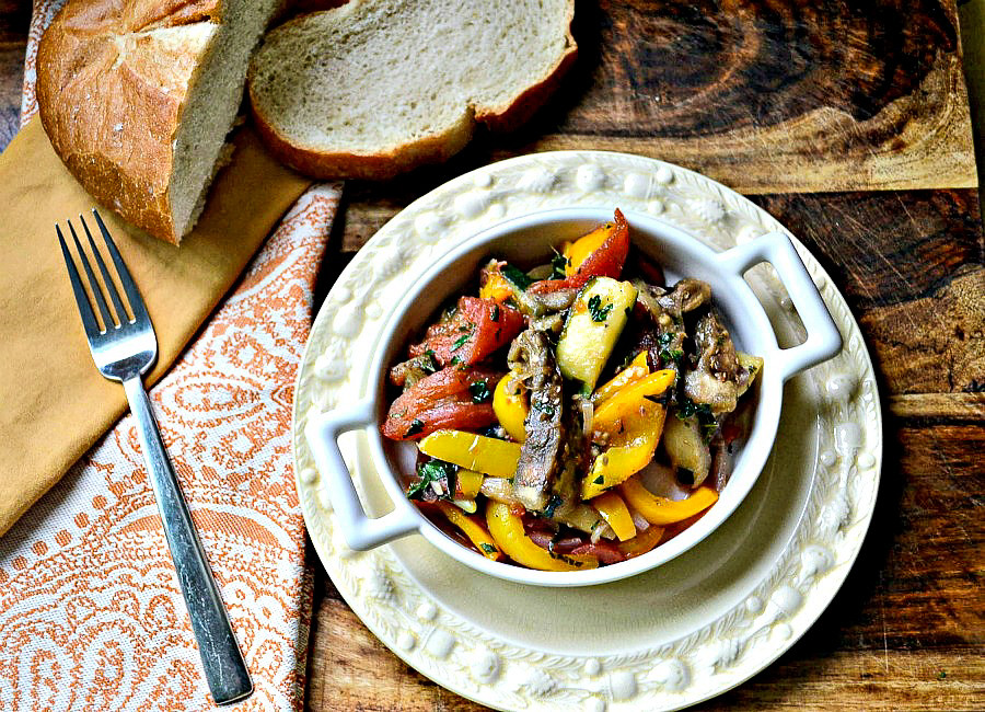 Julia Child's ratatouille recipe is a delicate and robust vegetable stew with tomatoes, zucchini and eggplant and layered with fresh herbs and garlic.