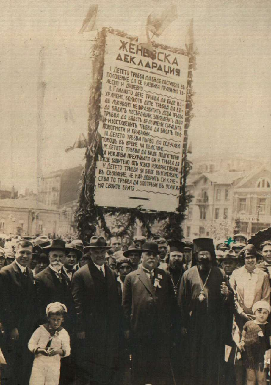 Children's Day, May 28, 1928, in Sofia, Bulgaria. The text on the poster is the Geneva Declaration. In front are Prime Minister Andrey Lyapchev and Metropolitan Stefan of Sofia. Photo courtesy of Central State Archive, Sofia.