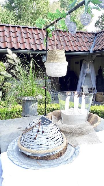 Glazen windlicht schelpenzand witte kaarsen