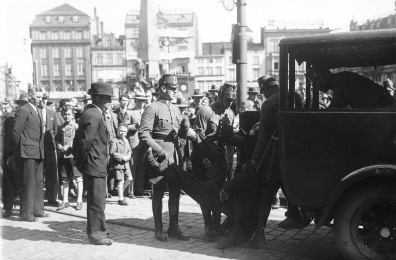 Danzig police arrest a protester in the aftermath of the 1933 Parliamentary Elections.