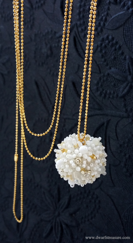 Exquisite long chain necklace with white glass bead ball charm