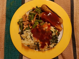 Mash, sausages, green beans, and gravy