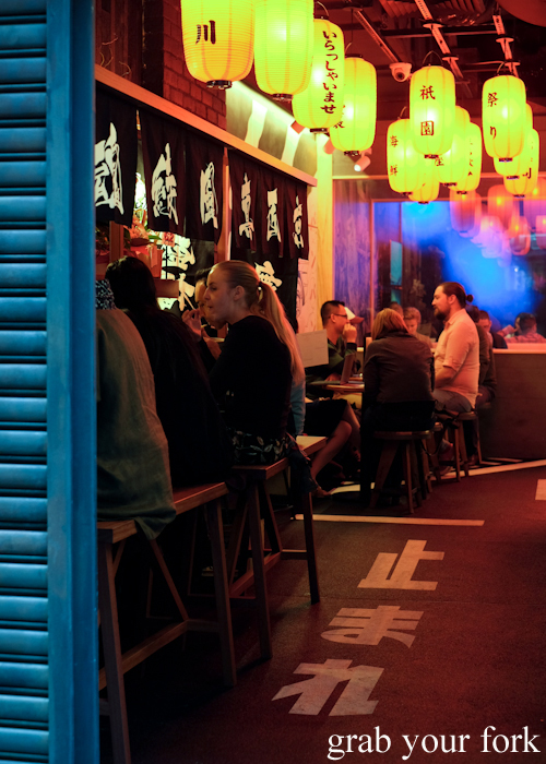 Entrance and stool seating at Bang Bang Japanese Izakaya Bar in Steam Mill and Darling Square Sydney