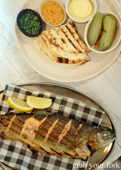 Whole grilled trout with grilled tortillas at Fich seafood restaurant in Petersham Sydney