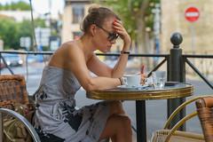 Woman reads a Newspaper