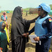 UNAMID peacekeeper interacts with a newly displaced woman in Aralciro site in Golo, Central Darfur