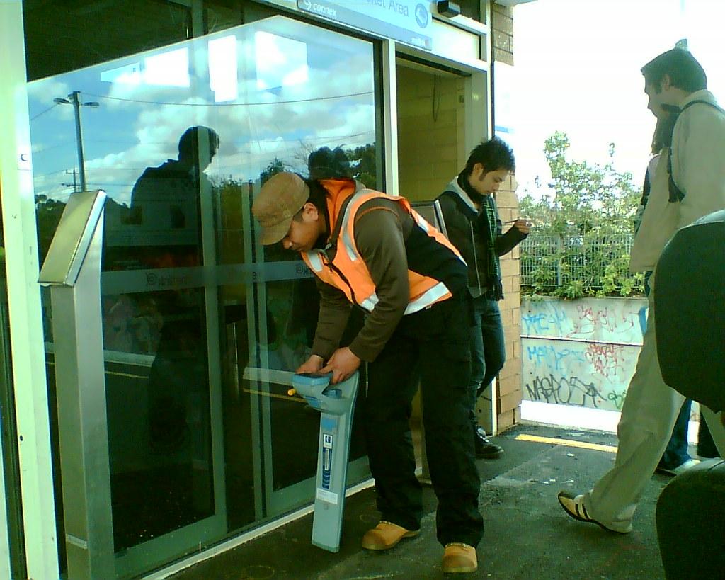 Installing Myki equipment at Bentleigh station