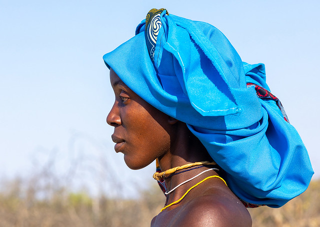 Portrait of a mucubal tribe woman with a blue headwear, Namibe Province, Virei, Angola