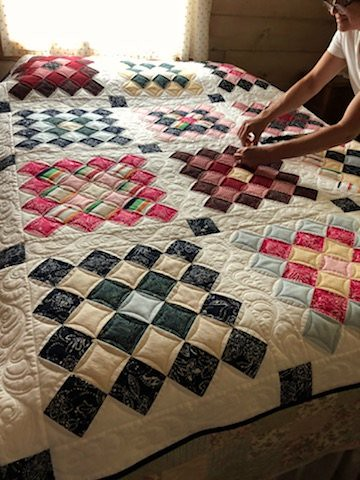 A memory quilt made from a woman's clothing