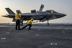 Sailor launches an F-35B Lightning II from the flight deck of USS Essex.
