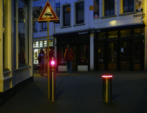 Gouda at night with lit-up street barriers that keep you on your toes when trying to make your way around the city