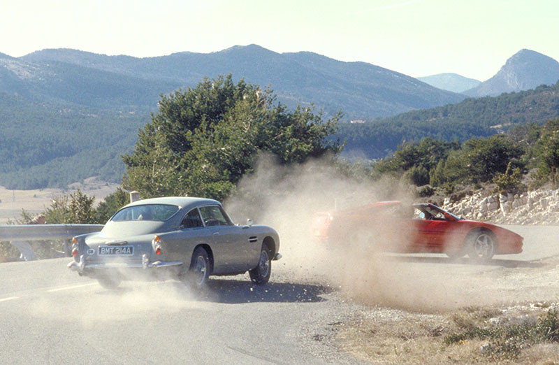 James Bond chases Xenia Onatopp through France, he in his Aston Martin DB5 and she in a Ferrari.
