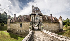 gazing across the drawbridge, in colour, at the beautiful Château de Boutemont, Ouilly-le-Vicomte, Calvados, Normandy, France - Photo of Le Torquesne