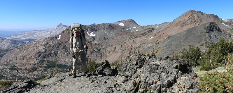 Posed shot of me at Dicks Pass with Jacks Peak, center, and Dicks Peak on the right