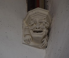 wide-eyed corbel cackling manically (19th Century)