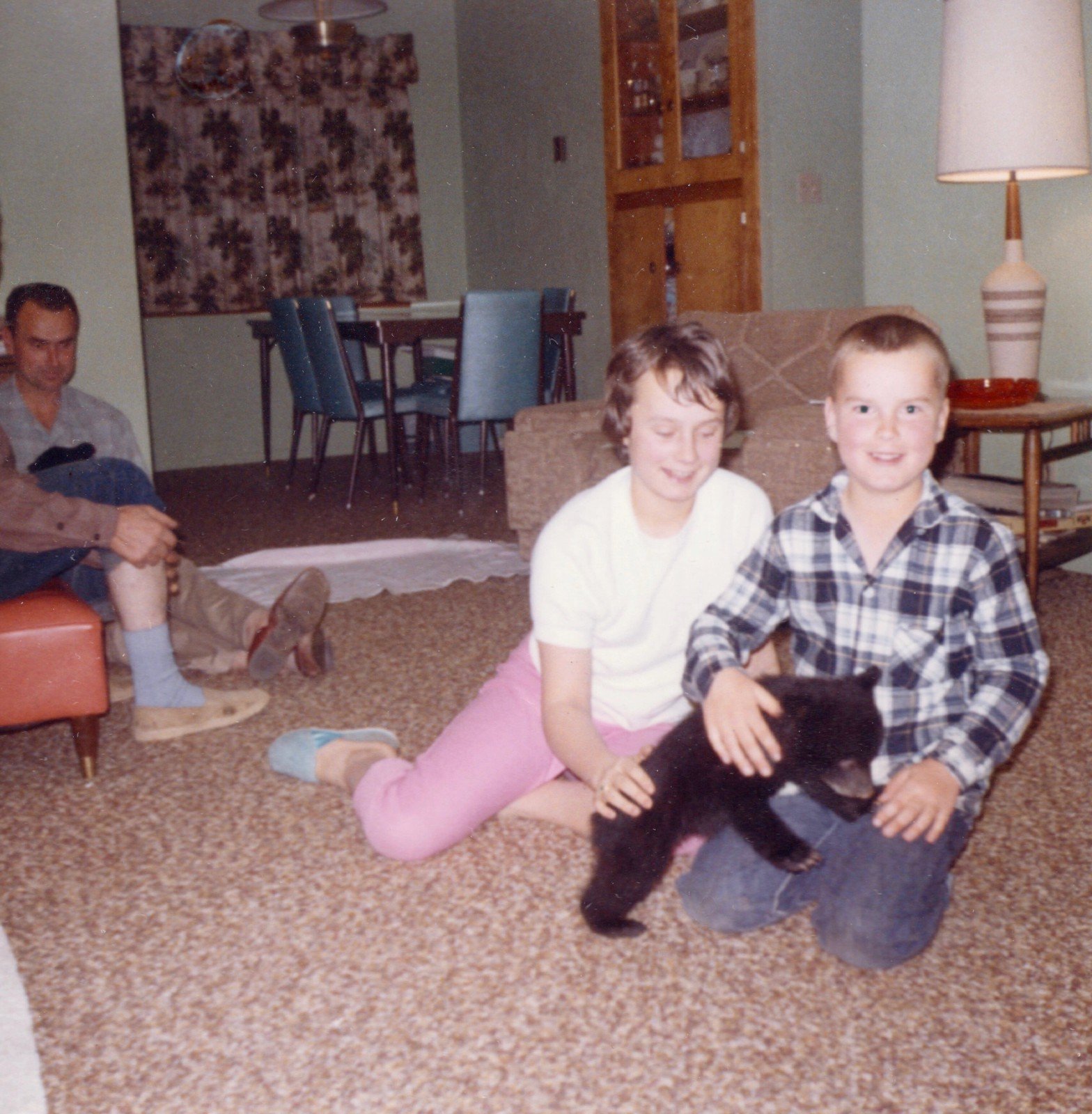 My brother and sister with a bear cub in our home, 1965.