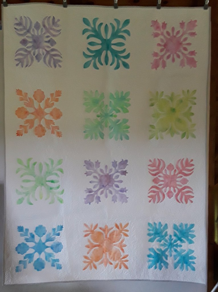 "I made this ""faux"" Hawaiian quilt. It's not applique, but stenciled with Shiva Paint sticks"