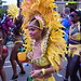 DSC_8536 Notting Hill Caribbean Carnival London Exotic Colourful Yellow Costume with Feather Headdress Girls Dancing Showgirl Performers Aug 27 2018 Stunning Ladies