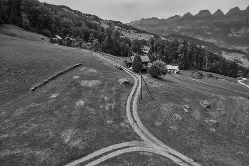 flumskleinberg cantonofstgallen switzerland 2018 gondolacableway gondola cableway gondelbahn saxli monochrome bw churfirstenmountainrange churfirsten mountain mountains road flumserbergsaxli ch