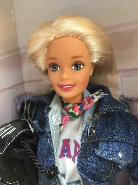 She's from 1996, and it looks like parts of her face paint are hand painted.  She's really quite pretty.  But she'll need a MTM body if she's going to hang around here...