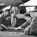 F-80 Shooting star crew chiefs play play checkers while waiting for their aircraft to be refueled. (U.S. Air Force photo)