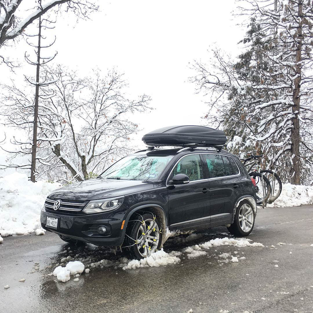 SUV with chains on tyres on a snowy road