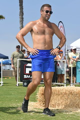 Man in Blue Shorts