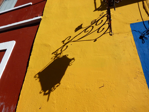 The shadow of a lantern on a yellow wall in Puebla, a UNESCO Heritage site in Mexico