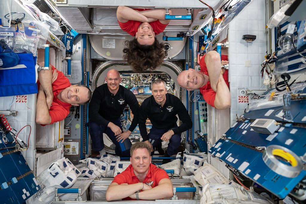 The Expedition 56 crew members pose for a fun portrait in the International Space Station's Harmony module
