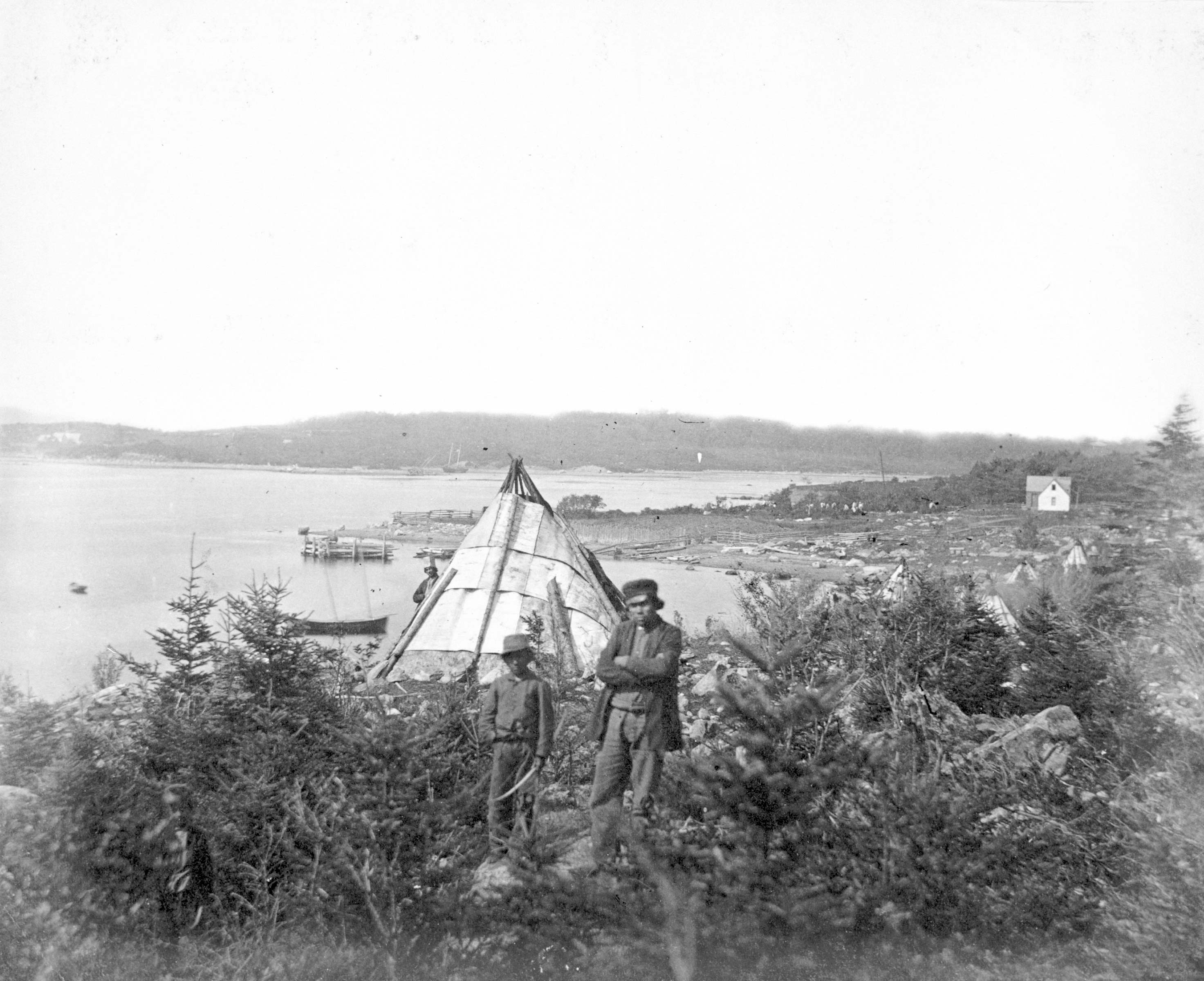 A Mi'kmaq father and child at Tuft's Cove settlement, Dartmouth, Nova Scotia, Canada, circa 1871.Nova Scotia Archives & Records Management NSARM accession no. 1992-412 Photographic Advertising Album, 1871, p. 18 / neg. no.: N-0418