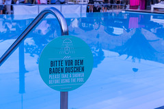 Please take a shower before using the pool. Sign