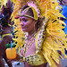 DSC_8536a Notting Hill Caribbean Carnival London Exotic Colourful Yellow Costume with Feather Headdress Girls Dancing Showgirl Performers Aug 27 2018 Stunning Ladies