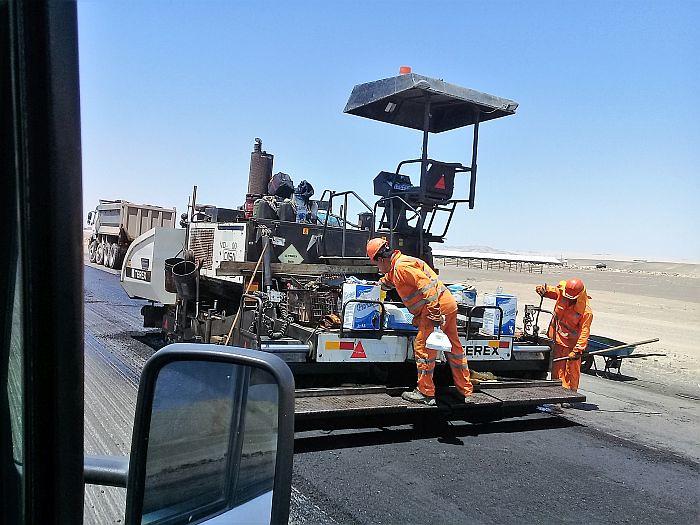 Road machine laying asphalt