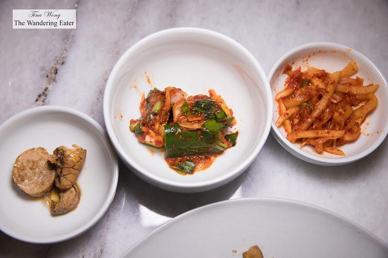Banchan - chestnuts cooked with fish stock, cucumber and radish kimchi and daikon kimchi