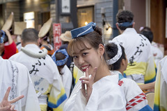 Girl attending Awa Odori matsuri smiles at the camera