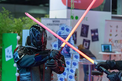 Sith cosplayers with crossed light sabers at Gamescom 2018