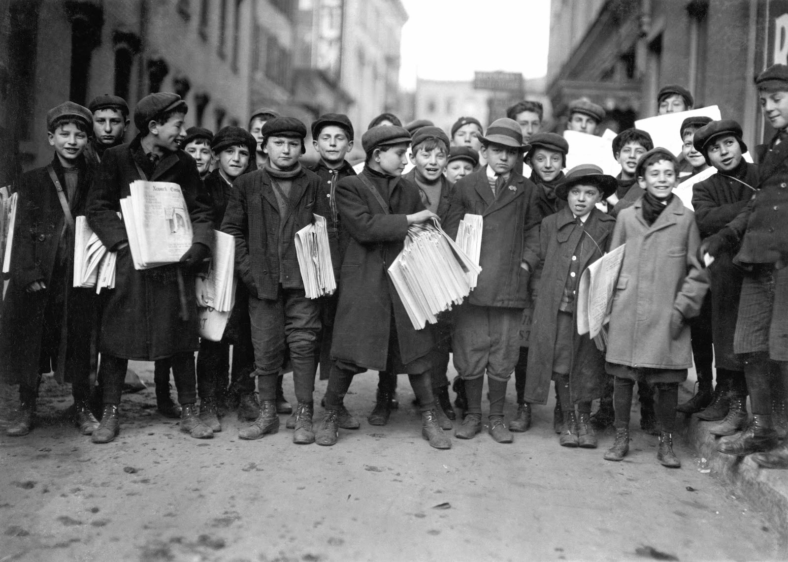 Young newsboys photographed by Lewis Hine in Newark, New Jersey, 1909.