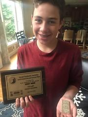Clay Barrineau son with exhibit award plaque