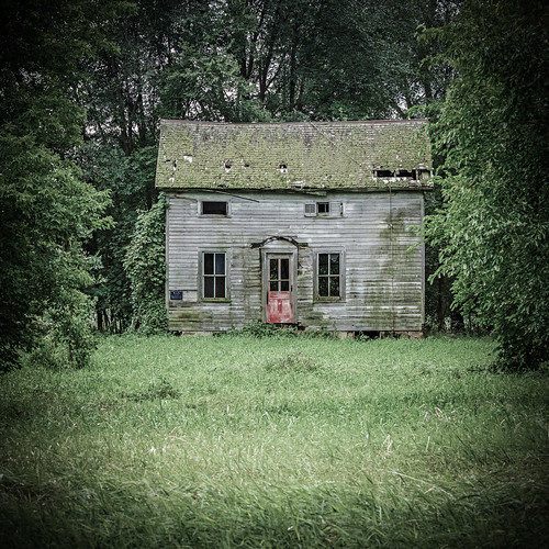 Old Wisconsin Farmhouse With A Red Door