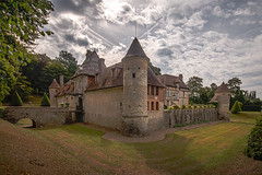 under a textured summer's day sky, in colour, the beautiful Château de Boutemont, Ouilly-le-Vicomte, Calvados, Normandy, France - Photo of Le Torquesne