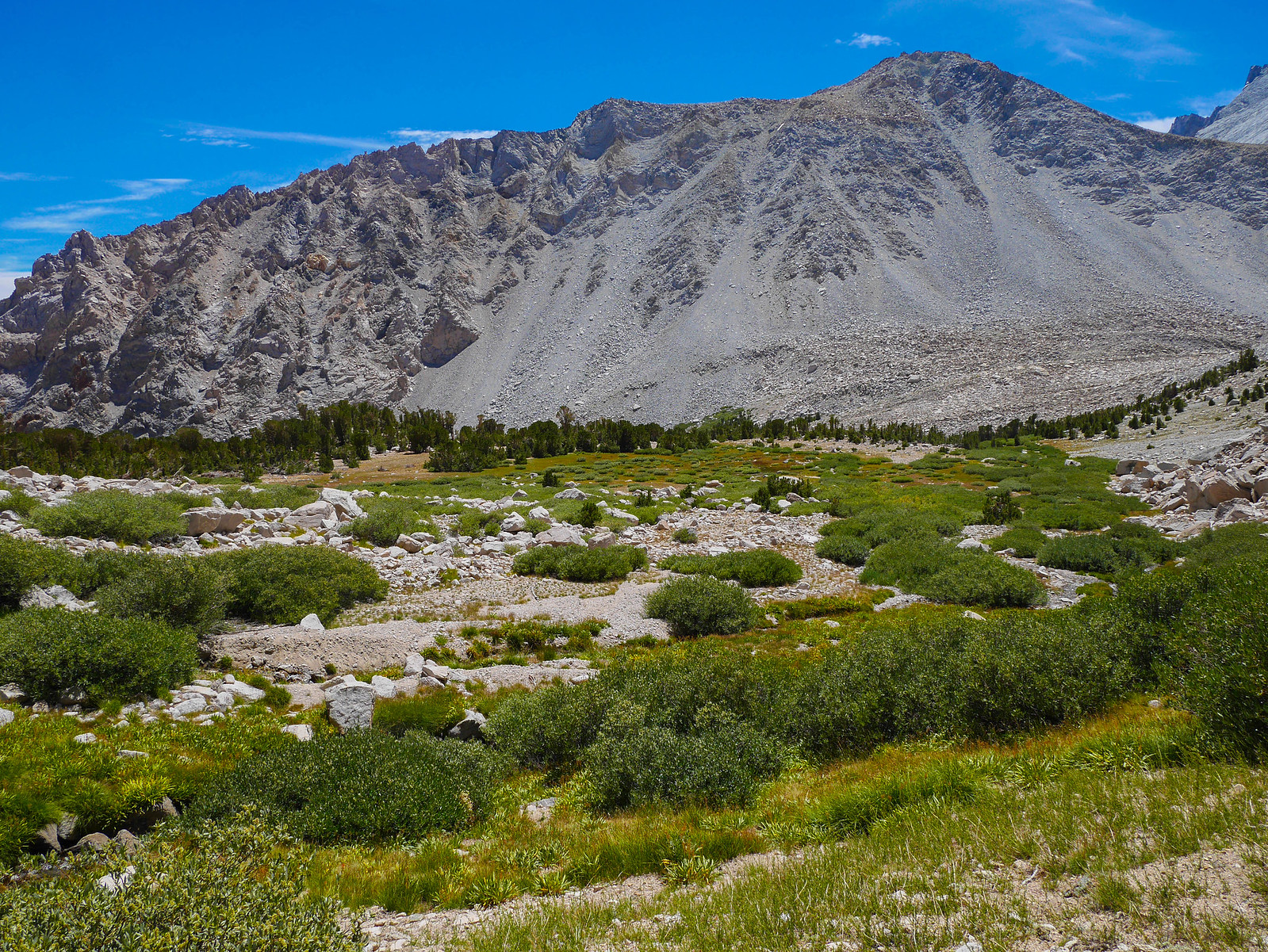 The Oasis area at the end of the talus below Junction Pass
