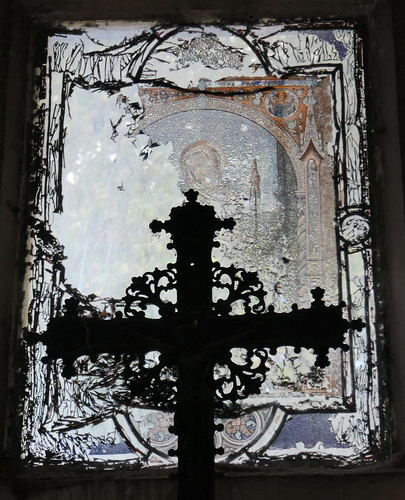 Ornate cross, disintegrating painted glass window - in the cemetery - Explored!