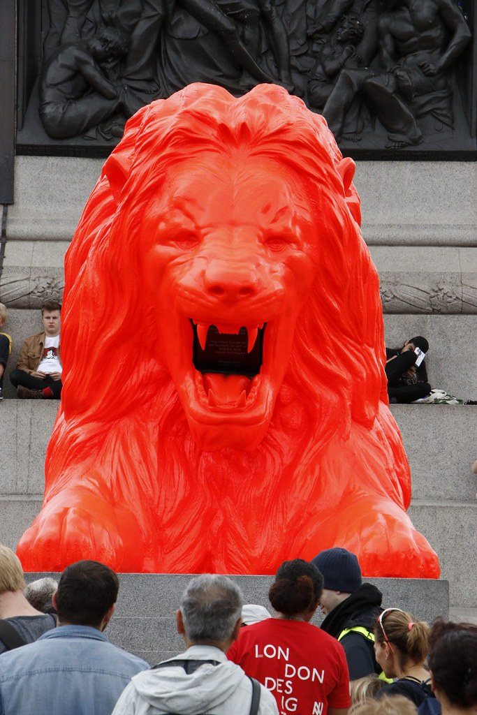 It's only here for a week and it recites poetry.  A giant fluorescent Lion has joined the four other big cats on trafalgar square this week. The bright red lion which roars poetry has been installed as part of the London Design Festival and was made by set designer, Es Devlin.