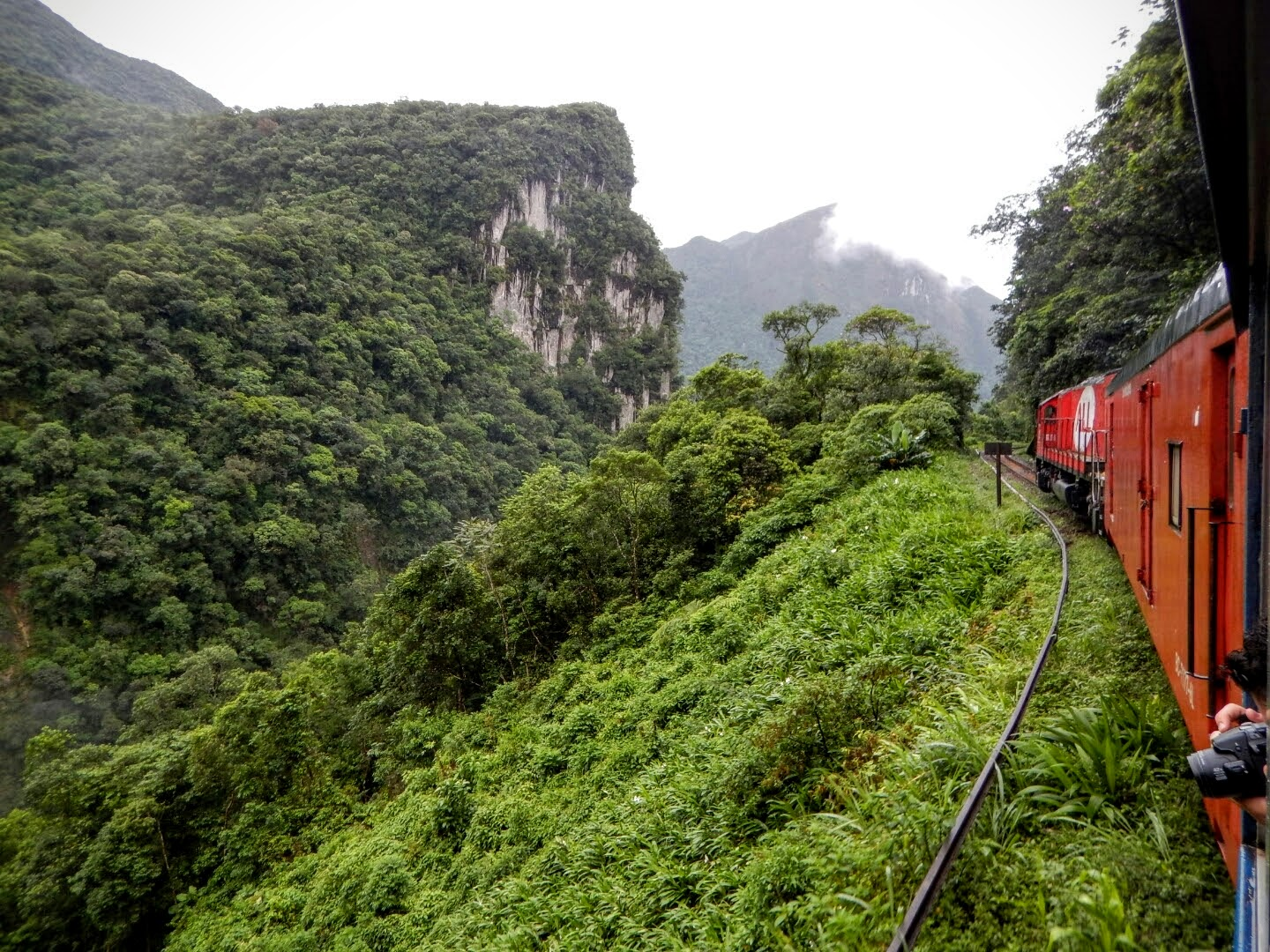 View from the train as it enters a steep sided valley